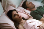 This image released by Sundance Now shows Shoshannah Stern, left, and Zach Gilford in a scene from