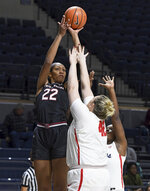 FILE - In this Jan. 4, 2018, file photo, South Carolina forward A'ja Wilson (22) takes a shot over Mississippi forward Shelby Gibson (42) during the first half of an NCAA college basketball game, in Oxford, Miss. Wilson, a 6-foot-5 senior, became the first three-time Southeastern Conference player of the year and set South Carolina's career scoring mark while mentoring the next group of Gamecocks and thriving as the best women's college basketball player. Wilson, who was the No. 1 high school recruit, is a leading candidate to be named national player of the year. (AP Photo/Thomas Graning, FIle)