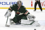 Minnesota Wild's goalie Alex Stalock deflects the puck in the second period of an NHL hockey game  against the Dallas Stars, Saturday, Jan. 18, 2020, in St. Paul, Minn. (AP Photo/Stacy Bengs)