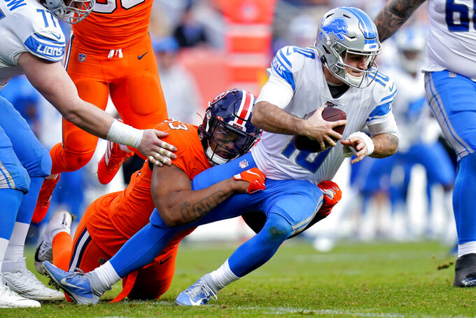 Denver Broncos defensive end Dre'Mont Jones (93) sacks Detroit Lions quarterback David Blough (10) during the first half of an NFL football game, Sunday, Dec. 22, 2019, in Denver. (AP Photo/Jack Dempsey)