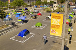 Rectangles designed to help prevent the spread of the coronavirus by encouraging social distancing line a city-sanctioned homeless encampment at San Francisco's Civic Center on Thursday, May 21, 2020. (AP Photo/Noah Berger)