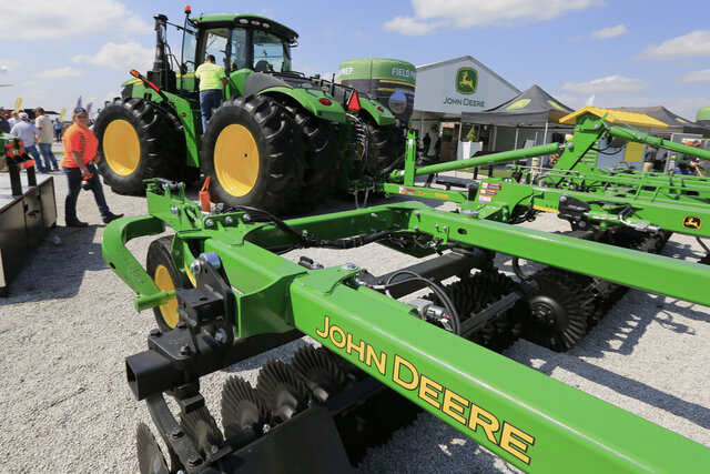 FILE - In this Sept. 10, 2019, file photo a John Deere tractor is on display at the Husker Harvest Days farm show in Grand Island, Neb. Deere & Co. reports earns on Thursday, Feb. 20, 2020. (AP Photo/Nati Harnik, File)