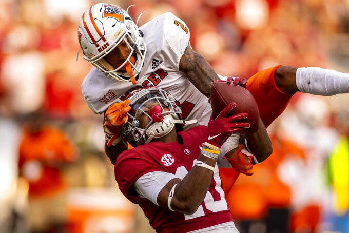 Alabama wide receiver JoJo Earle (10) pulls down a long pass from quarterback Paul Tyson (17) as Mercer defensive back Yahsyn McKee (2) tries to break up the play during the second half of an NCAA college football game, Saturday, Sept. 11, 2021, in Tuscaloosa, Ala. (AP Photo/Vasha Hunt)