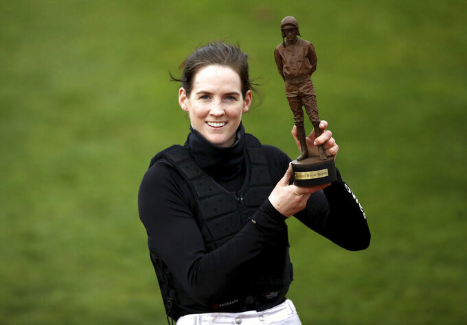 Rachel Blackmore poses with The Ruby Walsh Trophy for top jockey during day four of the Cheltenham Festival  at Cheltenham, England, Friday March 19, 2021. (Tim Goode/PA via AP)