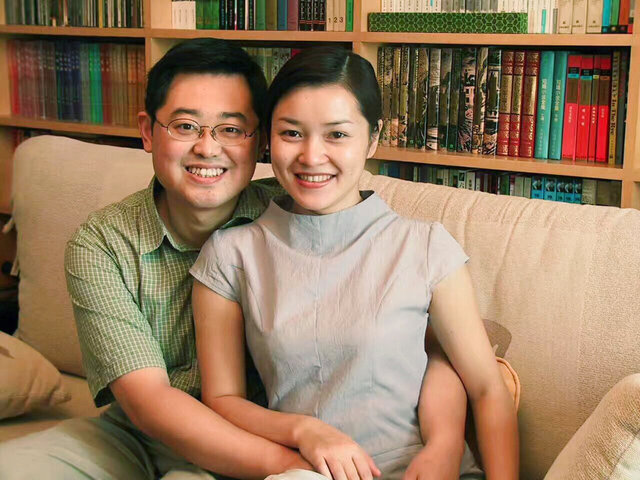 In this 2000 photo provided by ChinaAid, pastor Wang Yi, left, poses with his wife Jiang Rong at the study room of their home. China on Monday, Dec. 30, 2019, sentenced the prominent pastor who operated outside the Communist Party-recognized Protestant organization to nine years in prison. The People's Intermediate Court in the southwestern city of Chengdu said Wang Yi was also convicted of illegal business operations, fined and had his personal assets seized. (ChinaAid via AP)