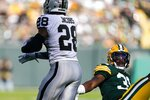 Oakland Raiders' Josh Jacobs gets past Green Bay Packers' Adrian Amos during the first half of an NFL football game Sunday, Oct. 20, 2019, in Green Bay, Wis. (AP Photo/Morry Gash)