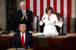 House Speaker Nancy Pelosi of Calif., tears her copy of President Donald Trump's s State of the Union address after he delivered it to a joint session of Congress on Capitol Hill in Washington, Tuesday, Feb. 4, 2020. Vice President Mike Pence is at left. (AP Photo/Alex Brandon)