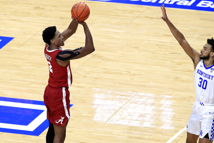 Alabama's Jordan Bruner (2) shoots near Kentucky's Olivier Sarr (30) during the first half of an NCAA college basketball game in Lexington, Ky., Tuesday, Jan. 12, 2021. (AP Photo/James Crisp)