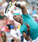 Rafael Nadal of Spain serves to Daniel Evans of Britain during the Rogers Cup men's tennis tournament Wednesday, Aug. 7, 2019, in Montreal. (Paul Chiasson/The Canadian Press via AP)