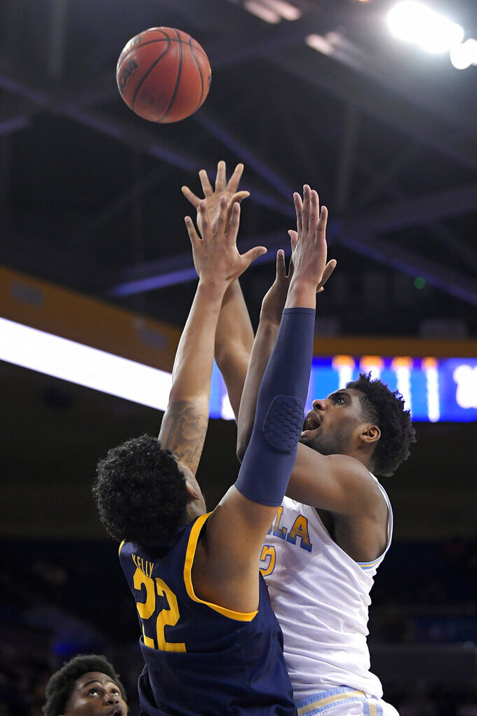 UCLA forward Cody Riley, right, shoots as California forward Andre Kelly defends during the second half of an NCAA college basketball game Sunday, Jan. 19, 2020, in Los Angeles. UCLA won 50-40. (AP Photo/Mark J. Terrill)