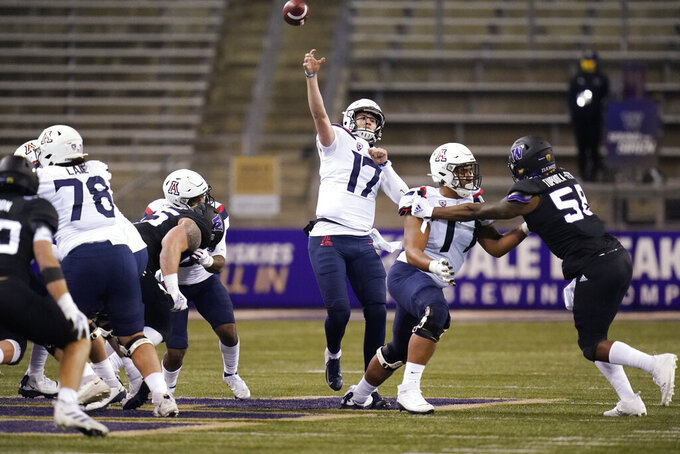 Arizona quarterback Grant Gunnell throws a pass during the second half of the team's NCAA college football game against Washington on Saturday, Nov. 21, 2020, in Seattle. (AP Photo/Elaine Thompson)