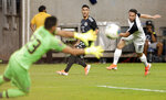 Mexico forward Uriel Antuna (22) watches as his shot on goal is caught by Costa Rica goalkeeper Leonel Moreira (23) as defender Bryan Oviedo (8) also watches during the first half of a CONCACAF Gold Cup soccer quarterfinal Saturday, June 29, 2019, in Houston. (AP Photo/Michael Wyke)