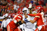 Kansas City Chiefs quarterback Patrick Mahomes (15) throws under pressure from Indianapolis Colts defensive tackle Margus Hunt (92) during the first half of an NFL football game in Kansas City, Mo., Sunday, Oct. 6, 2019. (AP Photo/Ed Zurga)