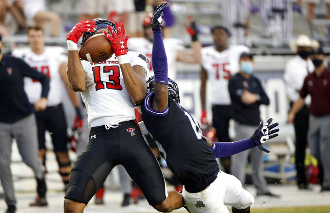 Texas Tech wide receiver Erik Ezukanma (13) catches a touchdown pass as TCU cornerback C.J. Ceasar II (16) defends during the second half of an NCAA college football game Saturday, Nov. 7, 2020, in Fort Worth, Texas. TCU won 34-18. (AP Photo/Ron Jenkins)