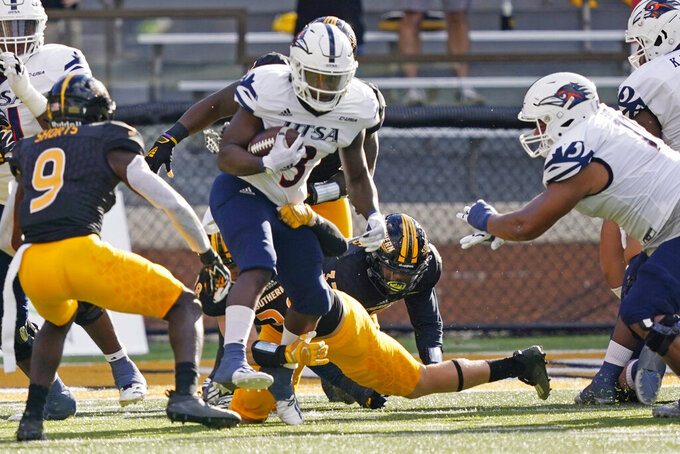 UTSA running back Sincere McCormick (3) runs over a Southern Mississippi defender for a short gain during the first half of an NCAA college football game, Saturday, Nov. 21, 2020, in Hattiesburg, Miss. (AP Photo/Rogelio V. Solis)