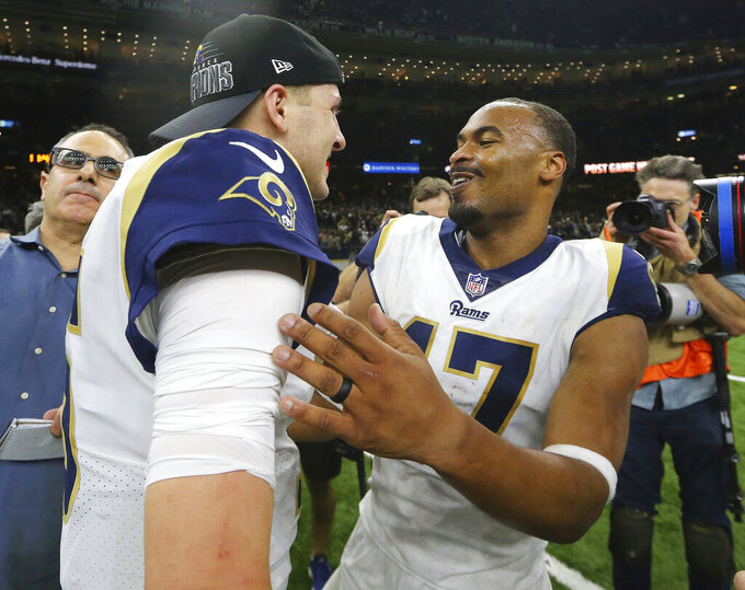 Los Angeles Rams' Jared Goff celebrates with Robert Woods after a game-winning field goal during overtime of the NFL football NFC championship game against the New Orleans Saints, Sunday, Jan. 20, 2019, in New Orleans. The Rams won 26-23. (AP Photo/David J. Phillip)