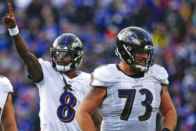FILE - In this Dec. 8, 2019, file photo, Baltimore Ravens quarterback Lamar Jackson (8) celebrates a 61-yard touchdown play as he walks off the field with offensive guard Marshal Yanda (73) during the second half of an NFL football game against the Buffalo Bills in Orchard Park, N.Y. In their quest to keep quarterback Lamar Jackson upright and running, the Baltimore Ravens have put a priority on fortifying their offensive line following the retirement of eight-time Pro Bowl guard Marshal Yanda. (AP Photo/John Munson, File)