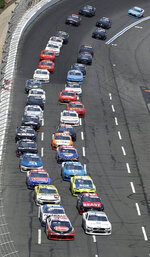 Drivers bring their cars out of Turn 4 for the start of the NASCAR Xfinity Series auto race at Charlotte Motor Speedway in Concord, N.C., Saturday, May 25, 2019. (AP Photo/Chuck Burton)