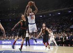 New York Knicks' Allonzo Trier (14) is defended by Cleveland Cavaliers' Jordan Clarkson (8) during the first half of an NBA basketball game Thursday, Feb. 28, 2019, in New York. (AP Photo/Frank Franklin II)