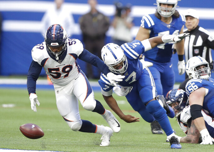 Denver Broncos linebacker Malik Reed (59) recovers a fumble by Indianapolis Colts quarterback Jacoby Brissett (7) during the second half of an NFL football game, Sunday, Oct. 27, 2019, in Indianapolis. (AP Photo/Michael Conroy)