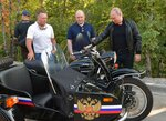 Russian President Vladimir Putin, right, looks at a Russia made