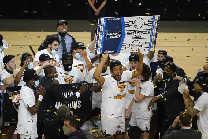 Cleveland State's Algevon Eichelberger celebrates with is teammates following an NCAA college basketball game in the men's Horizon League conference tournament championship game against Oakland, Tuesday, March 9, 2021, in Indianapolis. Cleveland State won 80-69 (AP Photo/Darron Cummings)