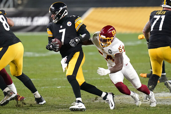 Pittsburgh Steelers quarterback Ben Roethlisberger (7) is forced out of the pocket by Washington Football Team outside linebacker Kevin Pierre-Louis (54) during the second half of an NFL football game, Monday, Dec. 7, 2020, in Pittsburgh. (AP Photo/Keith Srakocic)