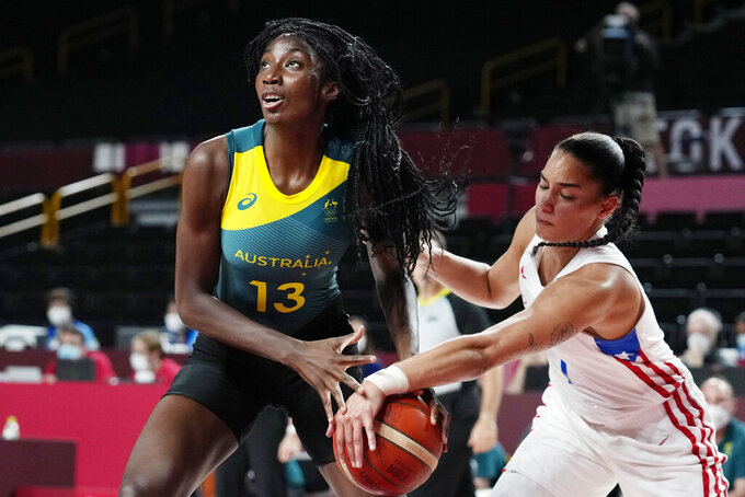 Australia's Ezi Magbegor (13) is defended by Puerto Rico's Tayra Melendez (1) during a women's basketball game at the 2020 Summer Olympics, Monday, Aug. 2, 2021, in Saitama, Japan. (AP Photo/Eric Gay)