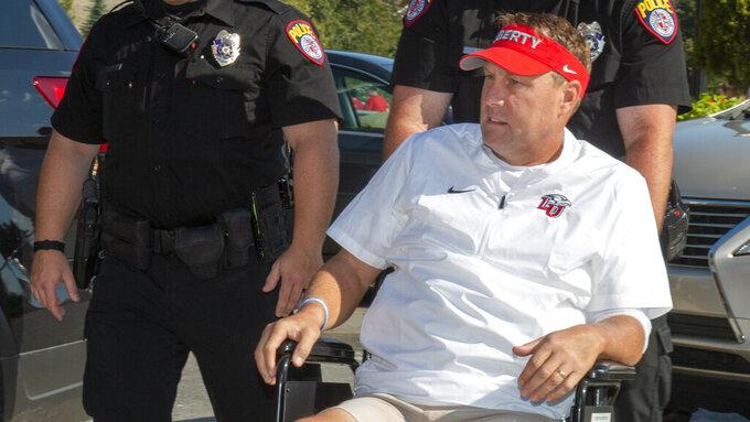Liberty coach Hugh Freeze on mend, awaits OK to travel