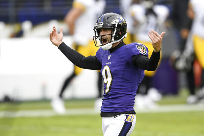 Baltimore Ravens kicker Justin Tucker reacts after kicking a field goal against the Pittsburgh Steelers during the first half of an NFL football game, Sunday, Nov. 1, 2020, in Baltimore. (AP Photo/Nick Wass)