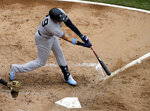 New York Yankees' Gio Urshela hits a one-run single against the Chicago White Sox during the third inning of a baseball game in Chicago, Sunday, June 16, 2019. (AP Photo/Nam Y. Huh)