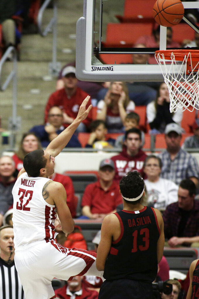 Washington State forward Tony Miller (32) shoots near Stanford forward Oscar da Silva (13) during the second half of an NCAA college basketball game in Pullman, Wash., Sunday, Feb. 23, 2020. Stanford won 75-57. (AP Photo/Young Kwak)