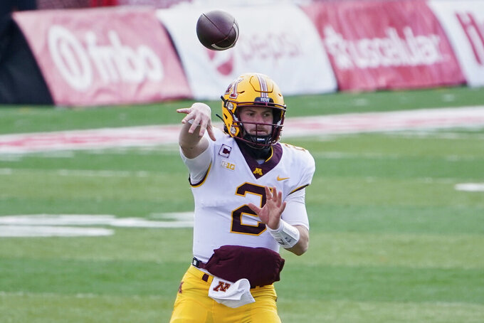 Minnesota quarterback Tanner Morgan (2) throws during the first half of an NCAA college football game against Nebraska in Lincoln, Neb., Saturday, Dec. 12, 2020. (AP Photo/Nati Harnik)