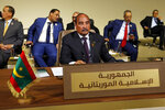 FILE - In this Jan. 20, 2019, file photo, Mauritania's President Mohamed Ould Abdel Aziz, center, attends the Arab Economic and Social Development Summit, in Beirut, Lebanon. Mauritanians are going to the polls on Saturday, June 22, 2019, as his preferred successor faces five opposition candidates in the West African nation threatened by Islamic extremism. (AP Photo/Bilal Hussein, File)