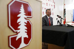 FILE - In this June 20, 2017, file photo, David Esquer smile during a press conference introducing him as the new head coach of the Stanford NCAA college baseball team in Stanford, Calif. Esquer didn't shy away from the tough task of following a coaching legend. Esquer instead leaped at the opportunity to take over for his mentor, Mark Marquess, as Stanford's baseball coach. Esquer begins his tenure for the Cardinal on Friday night, Feb. 16, 2018, when Stanford hosts Cal-State Fullerton at Sunken Diamond. (AP Photo/Marcio Jose Sanchez, File)
