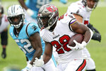 Tampa Bay Buccaneers running back Leonard Fournette (28) rushes past Carolina Panthers outside linebacker Tahir Whitehead (52) during the first half of an NFL football game Sunday, Sept. 20, 2020, in Tampa, Fla. (AP Photo/Mark LoMoglio)