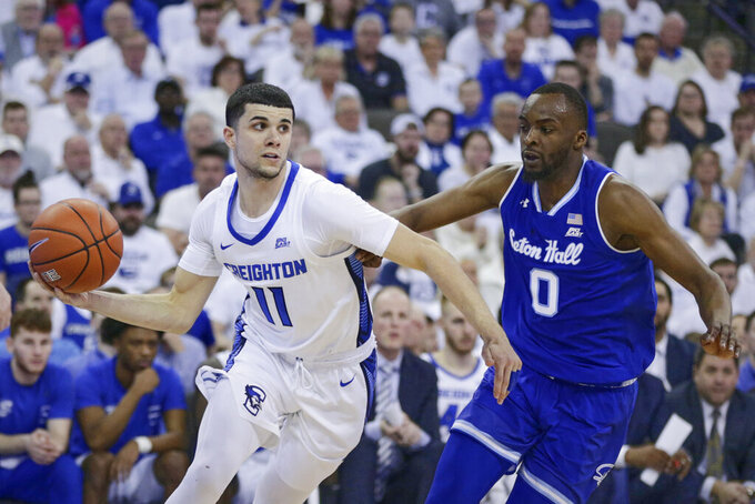Creighton's Marcus Zegarowski (11) drives around Seton Hall's Quincy McKnight (0) during the second half of an NCAA college basketball game in Omaha, Neb., Saturday, March 7, 2020. Creighton won 77-60. (AP Photo/Nati Harnik)