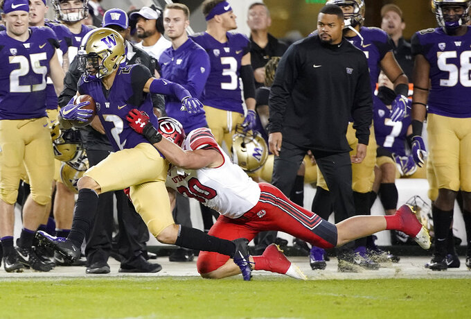 Washington wide receiver Aaron Fuller (2) tries to get away from Utah linebacker Cody Barton during the first half of the Pac-12 Conference championship NCAA college football game in Santa Clara, Calif., Friday, Nov. 30, 2018. (AP Photo/Tony Avelar)