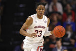 FILE - In this Jan. 18, 2020, file photo, Auburn forward Isaac Okoro (23) dribbles up court against Florida during the first half of an NCAA college basketball game in Gainesville, Fla. The Cleveland Cavaliers selected Okoro in the NBA draft Wednesday, Nov. 18, 2020. (AP Photo/Matt Stamey, File)