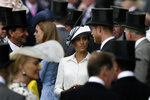 FILE - In this Tuesday, June 19, 2018 file photo, Britain's Prince Harry and Meghan, Duchess of Sussex, arrive on the first day of the Royal Ascot horse race meeting in Ascot, England. Sunday, May 19, 2019 marks the first wedding anniversary of the besotted couple. (AP Photo/Tim Ireland, File)