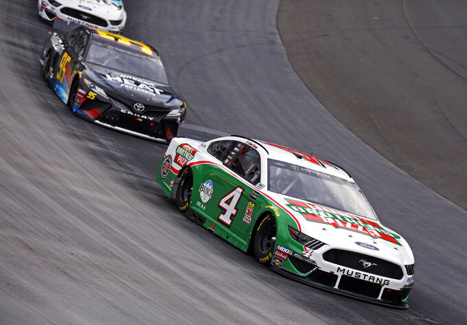 Kevin Harvick (4) leads Matt DiBenedetto (95) through a turn during a NASCAR Cup Series auto race, Sunday, April 7, 2019, in Bristol, Tenn. Harvick failed inspection three times before the race. (AP Photo/Wade Payne)