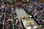In this handout photo provided by the UK Parliament, Britain's Prime Minister Theresa May delivers her statement in the House of Commons in London, Thursday, April 11, 2019. Granted a Brexit reprieve by the European Union, British Prime Minister Theresa May is urging lawmakers to pause, reflect on the need for compromise _ and then fulfill their
