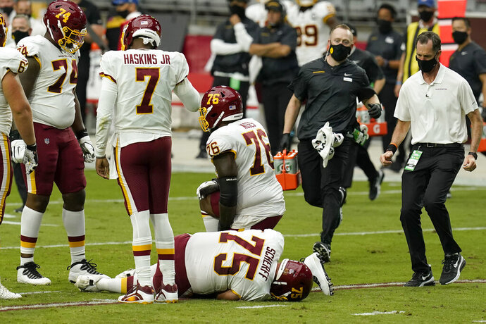 Washington Football Team offensive guard Brandon Scherff (75) lies on the turf after an injury against the Arizona Cardinals during the first half of an NFL football game, Sunday, Sept. 20, 2020, in Glendale, Ariz. Washington will be without its best offensive lineman for at least a couple of weeks after guard Brandon Scherff injured his right knee and missed the second half of a 30-15 loss at Arizona. AP Photo/Ross D. Franklin)