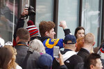 A Los Angeles Rams fan walks through the crowd before the New England Patriots parade through downtown Boston, Tuesday, Feb. 5, 2019, to celebrate their win over the Rams in Sunday's NFL Super Bowl 53 football game in Atlanta. (AP Photo/Michael Dwyer)