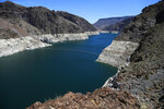 FILE - This May 31, 2018 file photo shows the reduced water level of Lake Mead behind Hoover Dam in Arizona. Several states that rely on a major Western river are pushing for federal legislation to implement a plan to keep key reservoirs from shrinking amid a prolonged drought. The Colorado River serves 40 million people in Arizona, California, Colorado, Nevada, New Mexico, Utah and Wyoming. Representatives from those states are meeting Tuesday, March 19, 2019, to sign a letter to Congress asking for support for so-called drought contingency plans. (AP Photo/Ross D. Franklin, File)