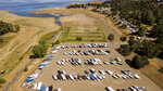 In an aerial view, boat docks sitting on dry land at the Browns Ravine Cove area of drought-stricken Folsom Lake, currently at 37% of the normal capacity, in Folsom, Calif., Saturday, May 22, 2021. California Gov. Gavin Newsom declared a drought emergency for most of the state. (AP Photo/Josh Edelson)