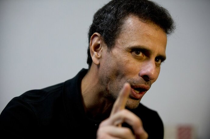 FILE - In this July 30, 2018 file photo, Venezuela's opposition leader Henrique Capriles speaks during an interview at his office in Caracas, Venezuela. Capriles broke on Wednesday, Sept. 2, 2020, with U.S.-backed leader Juan Guaido, whose coalition has vowed to boycott the crisis-torn nation's upcoming congressional elections claiming they're rigged. (AP Photo/Fernando Llano, File)