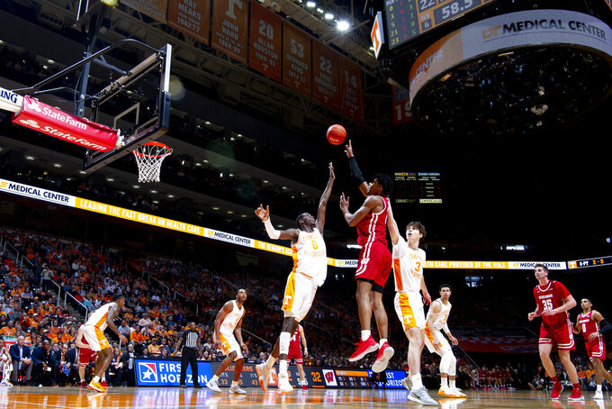 Wisconsin forward Aleem Ford (2) shoots the ball as Tennessee guard Davonte Gaines (0) and Tennessee forward Drew Pember (3) defend during an NCAA college basketball game, Saturday, Dec. 28, 2019 in Knoxville, Tenn. on Saturday, Dec. 28, 2019. (Calvin Mattheis/Knoxville News Sentinel via AP)