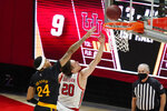 Utah forward Mikael Jantunen (20) lays the ball up as Arizona State forward Jalen Graham (24) defends in the first half during an NCAA college basketball game Saturday, March 6, 2021, in Salt Lake City. (AP Photo/Rick Bowmer)