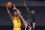 Southern California's Evan Mobley shoots over Connecticut's Tyrese Martin, front, and Adama Sanogo during the second half of an NCAA college basketball game Thursday, Dec. 3, 2020, in Uncasville, Conn. (AP Photo/Jessica Hill)